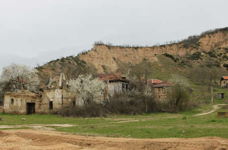 damaged houses: Rural scene with old damaged houses