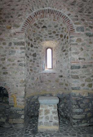 ecclesiastical: Ecclesiastical window above an ancient shrine, detail