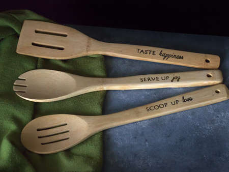 Three Wooden Spoons in a Kitchen with wording on the handles Zdjęcie Seryjne