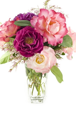 A fresh cut bouquet of colorful spring roses from a home garden, vertical with white background and copy space photo