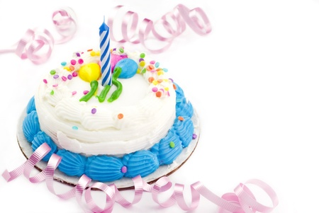 One year white birthday cake with candle white background copyspace