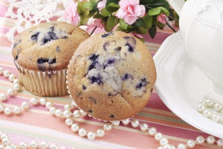 Fresh baked blueberry muffins at a tea party Imagens