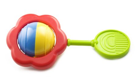 A bright colored baby rattle isolated on white background with copy space Imagens