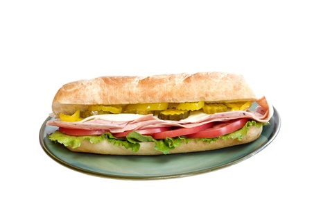Italian submarine sandwich on a plate with white background and copy space photo