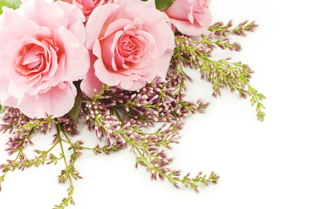 A bouquet of beautiful home grown pink roses with lilac isolated on a white background with copy space
