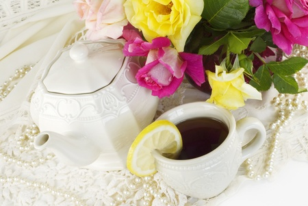 tea garden: A ladies tea party decorated with antique lace, pearls and fresh garden roses, horizontal with copy space