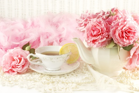 tea party: A sunny morning ladies breakfast tea with a teapot of fresh pink garden roses, horizontal with copy space
