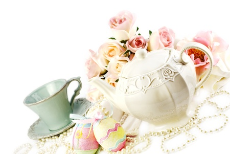 Easter tea set with teapot china cup and Easter decorations  diagonal with copy space