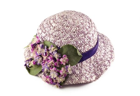 A womans purple hat with flowers, vintage, isolated on white, horizontal with copy space