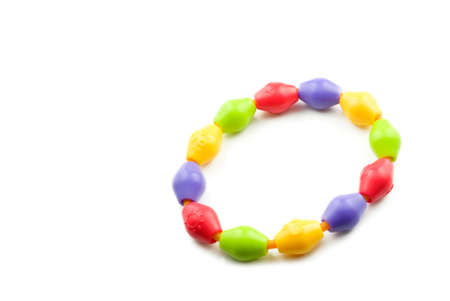 teething: A childs colorful teething ring isolated on a white horizontal background Stock Photo