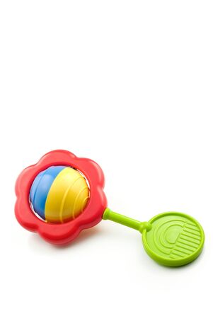 Colorful baby rattle on white background