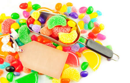 A scoop filled with colorful assorted jelly candies with blank gift tag and candy background Stock Photo - 9067995