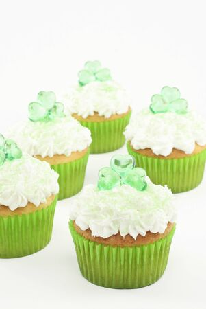 Delicious Saint Patricks Day cupcakes with selective focus, vertical with white copy space