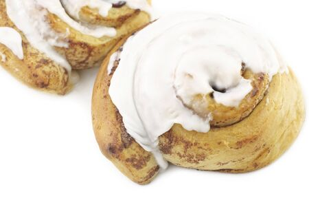 Fresh baked cinnamon rolls with icing, horizontal white background