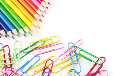 Bright Colored Pencils and Paperclips on a white background with copy space photo