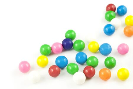Colored gumball spilled out on white background copy space Stockfoto