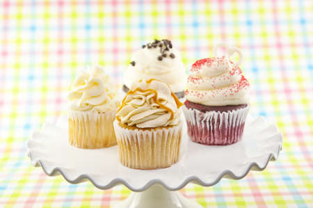 A variety of assorted cupcakes on a plate with selective focus on front cupcake Stock Photo - 9321009
