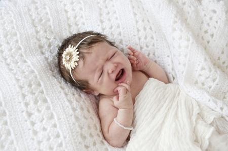 c27e71fee00 A beautiful little crying newborn baby girl
