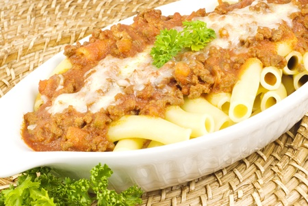 Baked Pasta with meat sauce topping with Mozzarella cheese with copy space Imagens