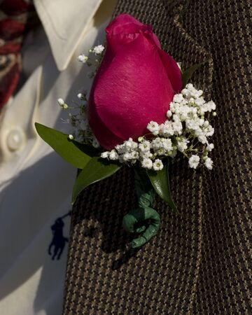 A rose on a mans jacket