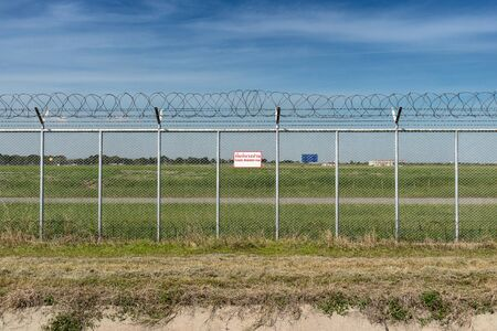 restricted area: Airport Security Restricted Area fence Stock Photo