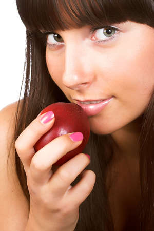 Beautiful young woman eating a peach. Isolated over white Stock Photo - 2039847
