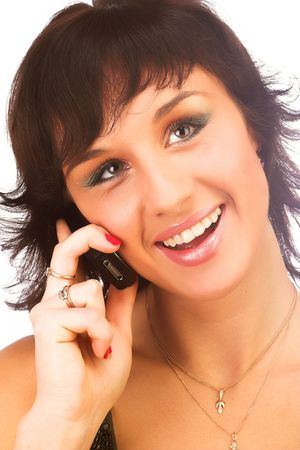 attractive young woman calling by cellular phone. Isolated over white.