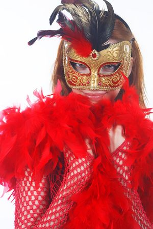 Portrait of attractive beautiful young woman wearing gold carnival mask Stock Photo - 2042783