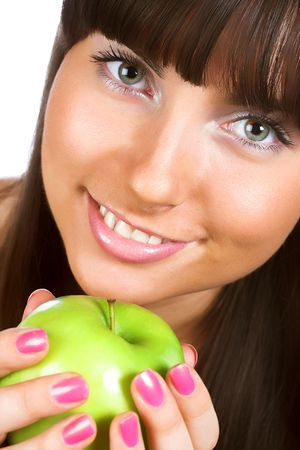Beautiful young woman holding a green apple photo