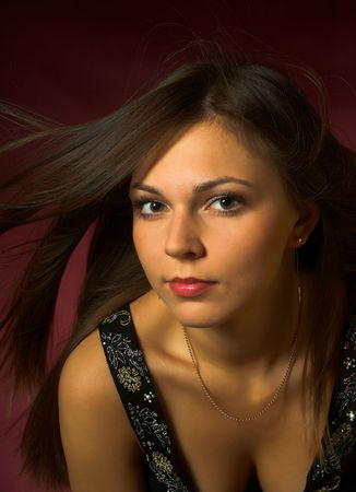 Portrait of a beautiful, sexy brunette girl with wind in the hair