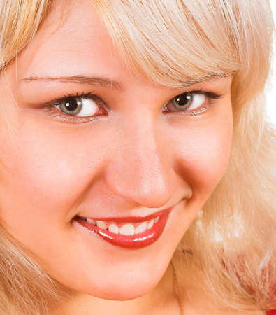 Beautiful young woman face. Close up. Over white background Stock Photo