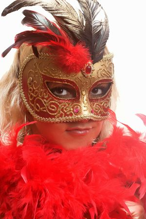 Portrait of attractive beautiful young woman wearing red carnival mask Stock Photo - 2051679
