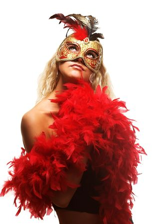 Portrait of attractive beautiful young woman wearing red carnival mask Standard-Bild