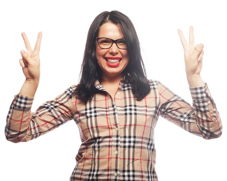 2 persons only: Happy smiling beautiful young woman showing two fingers or victory gesture