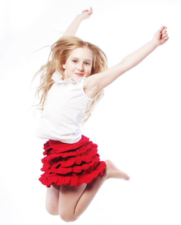 kids jumping: little girl jumps on a white background