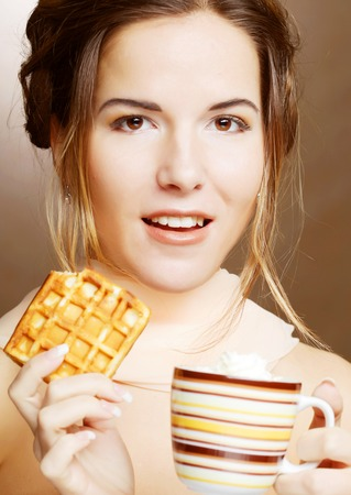 attractive woman with coffee and cookies photo