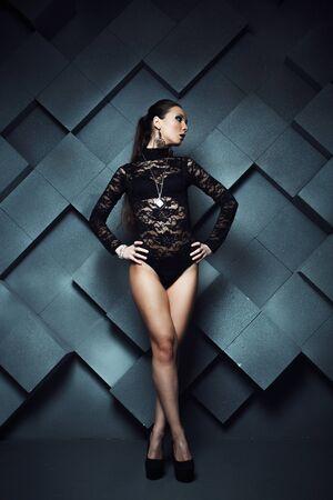 Beautiful brunette model over dark grunge background Stock Photo