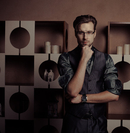 Fashion young man in luxury modern interior photo
