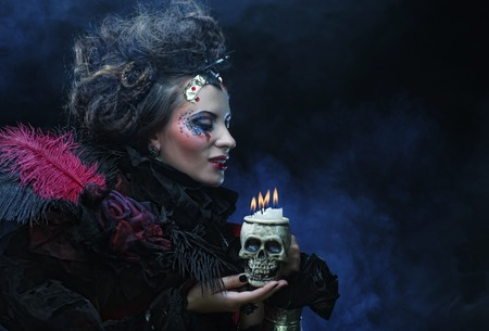 Picture a beautiful fantasy woman with skull. Halloween theme. Party theme. Stock Photo