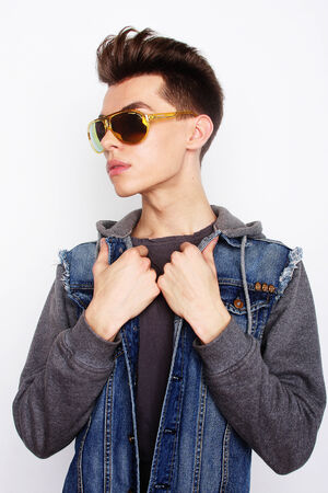 fashionable sunglasses: Fashion young man with fashionable sunglasses on white background