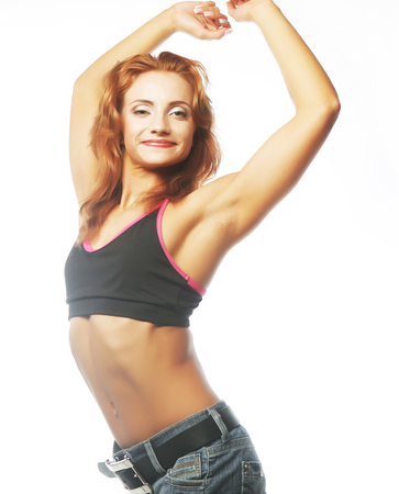 boast: sporty woman is showing her strong hands on gwhite background