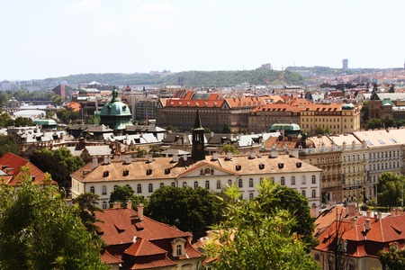 Houses with traditional red roofs in Prague. Travel photo photo