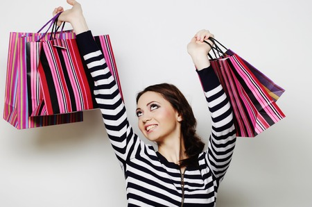 Portrait of young happy smiling woman with shopping bags. photo