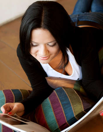 periodical: young woman is reading the magaziner Stock Photo