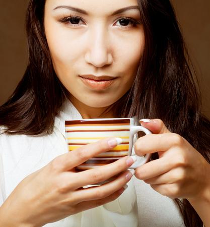 asian model: Beautiful asian woman drinking coffee or tea Stock Photo