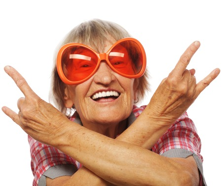 Senior woman wearing big sunglasses doing funky action isolated on white background Stock Photo