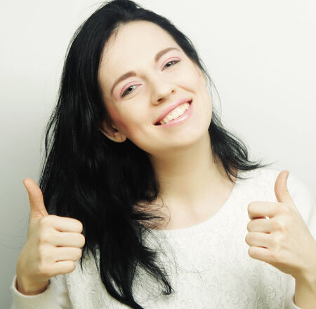 thumbup: Happy Young Woman Showing Thumb Up Stock Photo