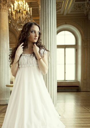 victorian lady: Portrait of a beautiful young victorian lady in white dress.Russian palace. Stock Photo