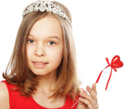 happy little girl in red dress with red heart photo
