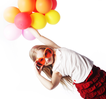 Little girl with balloons and orange sunglasses photo